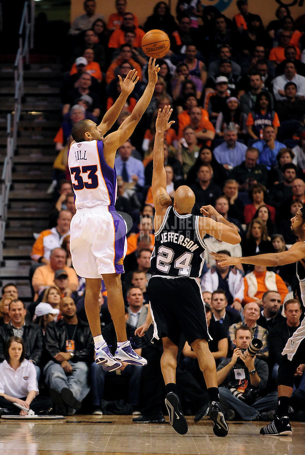 Dec. 15, 2009; Phoenix, AZ, USA; Phoenix Suns forward (33) Grant Hill shoots over San Antonio Spurs forward (24) Richard Jefferson at the US Airways Center. The Suns defeated the Spurs 116-104. Mandatory Credit: Mark J. Rebilas-
