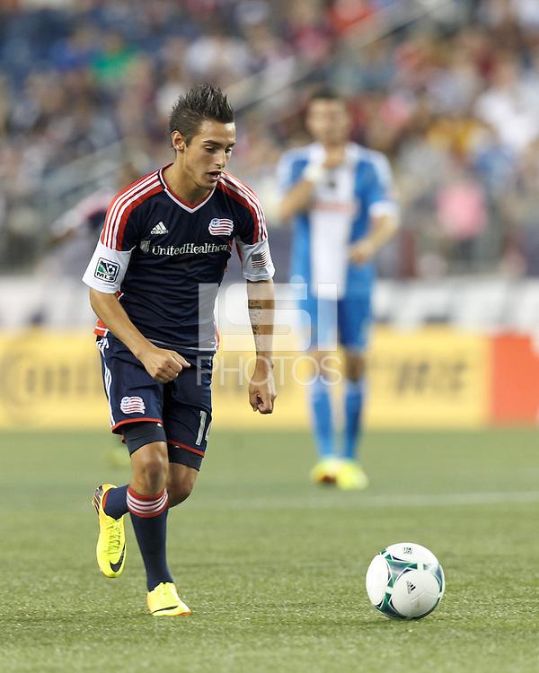 New England Revolution midfielder Diego Fagundez (14) on the attack.  In a Major League Soccer (MLS) match, the New England Revolution (dark blue) defeated Philadelphia Union (light blue), 5-1, at Gillette Stadium on August 25, 2013.