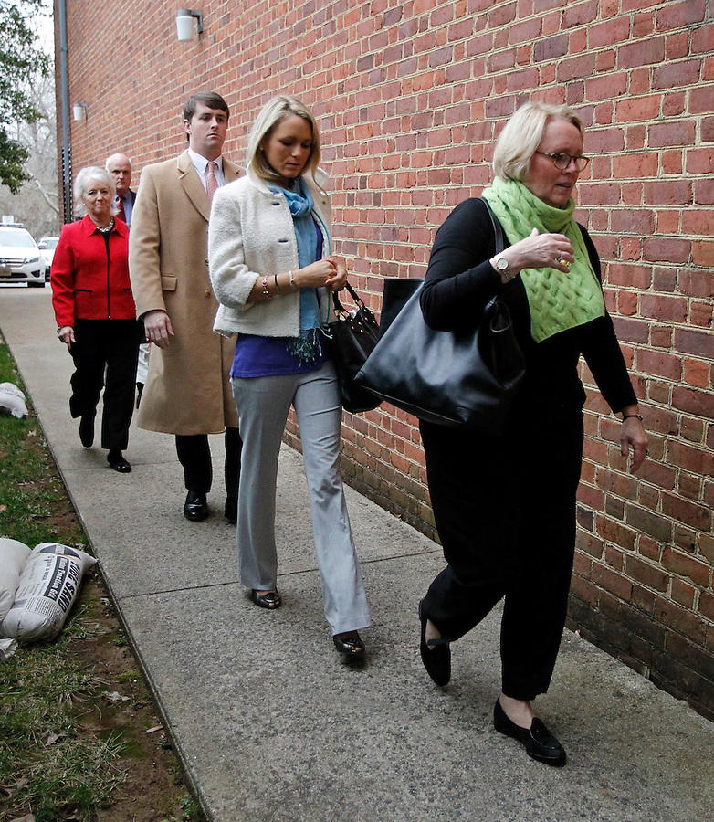 CHARLOTTESVILLE, VA - FEBRUARY 14: From right, Yeardley Love's mother Sharon Love and sister Lexie are escorted with family members to the Charlottesville Circuit courthouse for the George Huguely trial. Huguely was charged in the May 2010 death of his girlfriend Yeardley Love. She was a member of the Virginia women's lacrosse team. Huguely pleaded not guilty to first-degree murder. (Credit Image: © Andrew Shurtleff