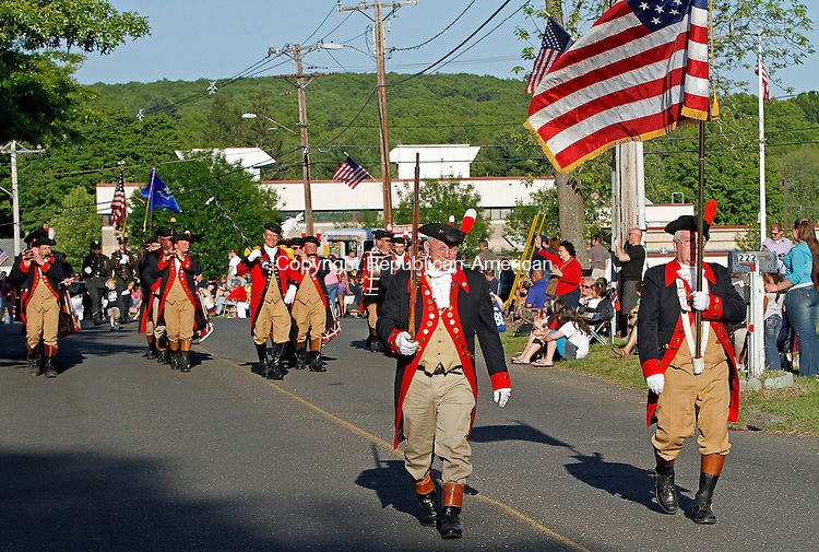 Wolcott, CT-052713MK20 Members of the Mattatuck Fife and Drum Corps march during the Memorial Day parade in Wolcott on Monday evening. Michael Kabelka / Republican-American.