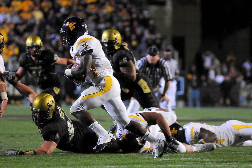 18 September 08: West Virginia running back Noel Devine runs the ball against Colorado. The Colorado Buffaloes defeated the West Virginia Mountaineers 17-14 in overtime at Folsom Field in Boulder, Colorado. For Editorial Use Only.