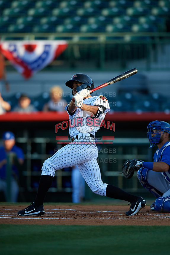 Florida Fire Frogs center fielder Ray-Patrick Didder (11) follows through on a swing during a game against the Dunedin Blue Jays on April 10, 2017 at Osceola County Stadium in Kissimmee, Florida.  Florida defeated Dunedin 4-0.  (Mike Janes/Four Seam Images)