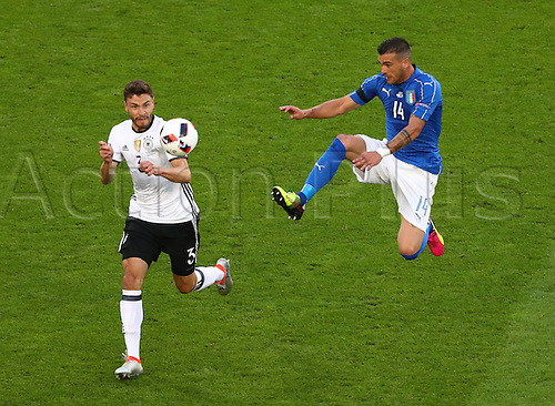02.07.2016. Bordeaux, France.  Germany's Jonas Hector (l) and Italy's Stefano Sturaro chase the loose ball during the UEFA EURO 2016 quarter final  match between Germany and Italy at the Stade de Bordeaux in Bordeaux, France, 02 July 2016.