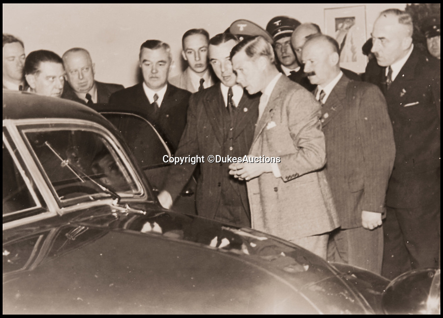 BNPS.co.uk (01202 558833)<br /> Pic: DukesAuctions/BNPS.<br /> <br /> Daimler chairman Dr Wilhem Kissel shown Edward around the factory.<br /> <br /> Remarkable photos of Edward VIII touring a car factory during his controversial visit to Nazi Germany in 1937 have been unearthed.<br /> <br /> Huge crowds turned out to catch a glimpse of the former King, rumoured to be a strong supporter of the Nazi party and the fascist cause, who even walked through a guard of Nazi troops giving Hitler salutes.<br /> <br /> The Duke of Windsor, who had abdicated the previous year, was accompanied by high ranking Nazi party officials and even an SS officer whilst touring the Mercedes-Benz factory in Stuttgart.<br /> <br /> During the trip, the Duke had a private meeting with Hitler at his retreat in Berchtesgaden and was infamously photographed giving Nazi salutes.