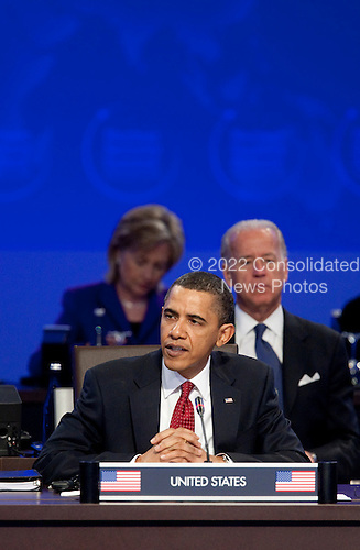 United States President Barack Obama speaks during the opening plenary session with  U.S. Vice President Joseph Biden, right, and Hillary Clinton, U.S. secretary of state, during the Nuclear Security Summit at the Washington Convention Center in Washington, D.C., U.S., on Tuesday, April 13, 2010. Ukraine's agreement to relinquish its entire stockpile of highly enriched uranium gave Obama the first concrete result for a summit he convened on securing the world's atomic material..Credit: Andrew Harrer / Pool via CNP