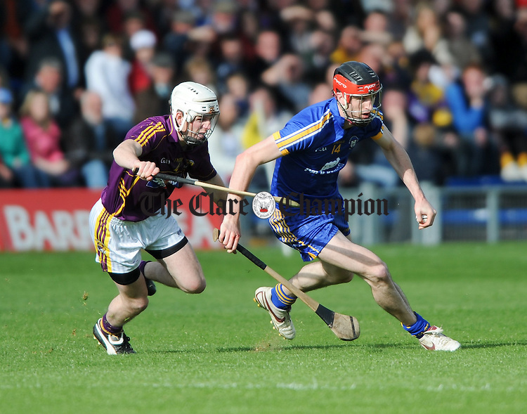 Darach Honan of Clare in action against Ciaran Kenny of Wexford during the Division 2 National League final at Thurles. Photograph by John Kelly.
