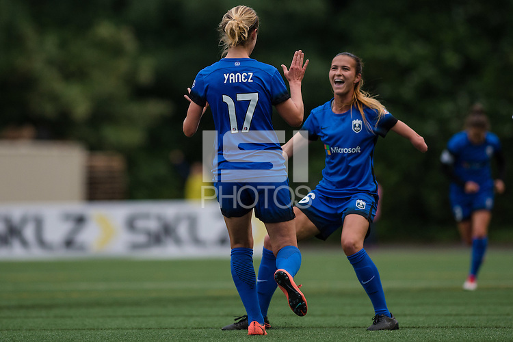 Seattle, WA - Thursday, May 26, 2016: Seattle Reign FC midfielder Beverly Yanez (17) celebrates scoring with Seattle Reign FC midfielder Carson Pickett (16). The Seattle Reign FC of the National Women's Soccer League (NWSL) and the Arsenal Ladies FC of the Women's Super League (FA WSL) played to a 1-1 tie during an international friendly at Memorial Stadium.