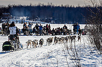 Ketil Reitan passes spectators out picnicing on Long Lake after leaving the start during the Restart of the 2016 Iditarod in Willow, Alaska.  March 06, 2016.