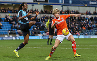 Marcus Bean of Wycombe Wanderers challenges Cameron McGeehan of Luton Town during the Sky Bet League 2 match between Wycombe Wanderers and Luton Town at Adams Park, High Wycombe, England on 6 February 2016. Photo by David Horn.