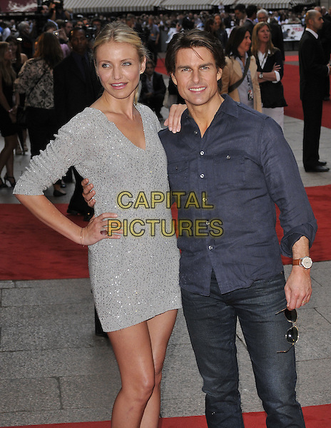 "CAMERON DIAZ & TOM CRUISE.""Knight and Day"" UK film premiere, Odeon cinema Leicester Square, London, England, UK, July 22nd 2010..half length navy blue shirt grey gray sequined sequin silver sweater jumper v-neck dress knitted arm around jeans smiling hand on hip .CAP/CAN.©Can Nguyen/Capital Pictures."