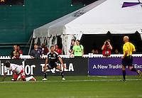 WASHINGTON, D.C - April 12 2014: Davy Arnaud  argues for a penalty kick call to referee Allen Chapman in D.C. United vs the New York Red Bulls MLS match at RFK Stadium, in Washington D.C. United won 1-0.