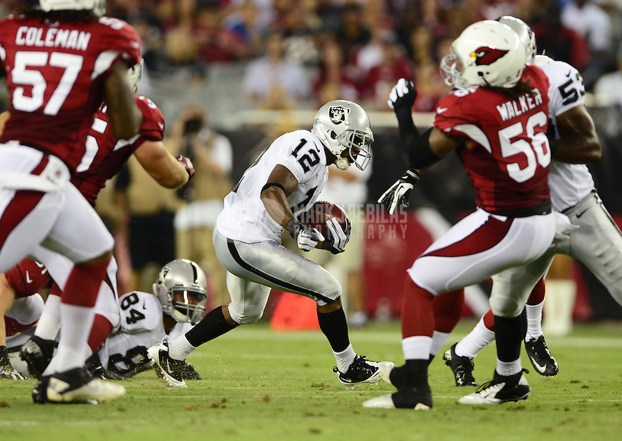 Aug. 17, 2012; Glendale, AZ, USA; Oakland Raiders wide receiver (12) Jacoby Ford against the Arizona Cardinals during a preseason game at University of Phoenix Stadium. The Cardinals defeated the Raiders 31-27. Mandatory Credit: Mark J. Rebilas-