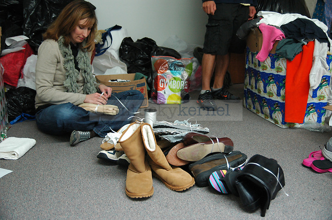 Public Health Graduate student Jessica Jones ties together shoes for the Wildcat Warmth project at the Reynolds building on Thursday November 12th 2009. Photo by Jon Reynolds | Staff