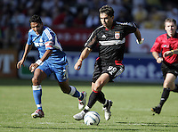 D.C. United's Jaimie Moreno dribble through the Kansas City defense  during a 3-2 victory at the MLS Cup, at the Home Depot Center, in Carson, Calif., Sunday, Oct. 14, 2004.
