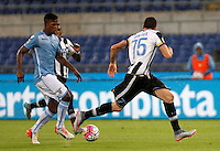 Calcio, Serie A: Lazio vs Udinese. Roma, stadio Olimpico, 13 settembre 2015.<br /> Lazio&rsquo;s Keita Diao, left, is challenged by Udinese's Thomas Heurtaux during the Italian Serie A football match between Lazio and Udinese at Rome's Olympic stadium, 13 September 2015.<br /> UPDATE IMAGES PRESS/Isabella Bonotto