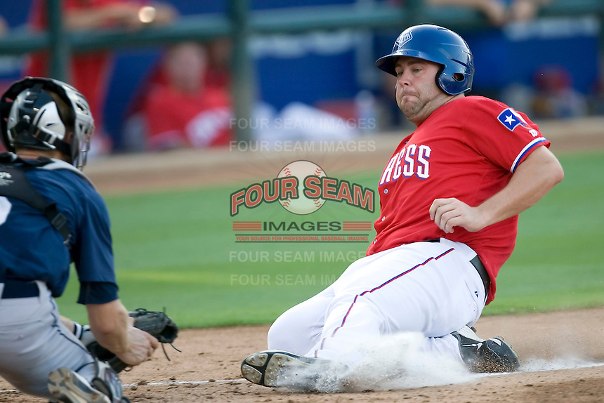 Round Rock Express outfielder Brad Nelson #30 slides but is out at the plate during a game against the New Orleans Zephyrs at the Dell Diamond on July 20, 2011 in Round Rock, Texas.  New Orleans defeated Round Rock 14-11.  (Andrew Woolley/Four Seam Images)