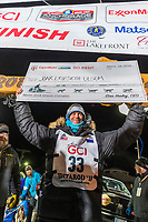 Joar Leifseth Ulsom holds up his winner's check at the finish line in Nome, Alaska early on Wednesday morning March 14th as he wins the 46th running of the 2018 Iditarod Sled Dog Race.  He finished in 9 days 12 hours 00 minutes and 00 seconds<br /> <br /> Photo by Jeff Schultz/SchultzPhoto.com  (C) 2018  ALL RIGHTS RESERVED