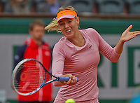 France, Paris, 26.05.2014. Tennis, Roland Garros,  Maria Sharapova (RUS) in action in her match  against Ksenia Pervak (RUS)<br /> Photo:Tennisimages/Henk Koster