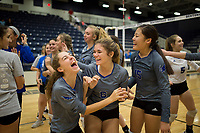 NWA Democrat-Gazette/CHARLIE KAIJO Rogers High School girls volleyball players react following a win over Bentonville West High School during the girl's volleyball game on Thursday, October 12, 2017 at Bentonville West High School in Centerton.