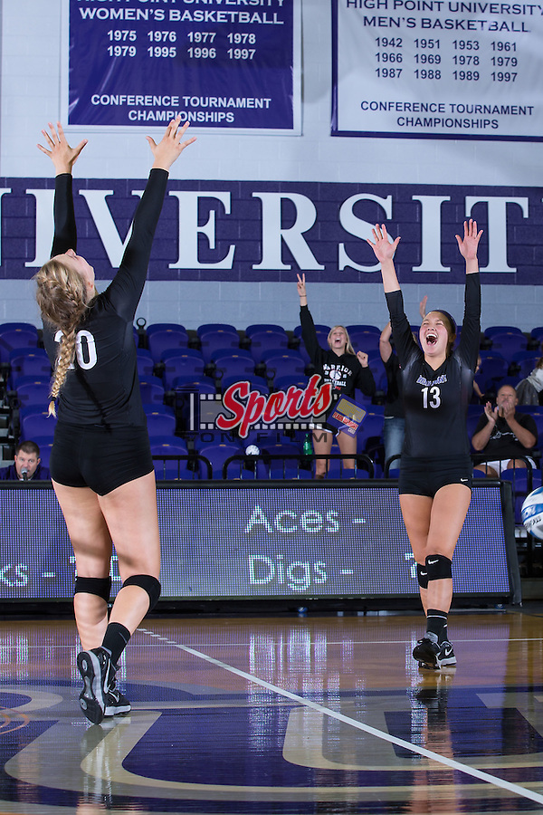 Wavie Chin (13) and Haley Barnes (20) of the High Point Panthers celebrate after scoring a point against the Marshall Thundering Herd at the Panther Invitational at the Millis Athletic Center on September 12, 2015 in High Point, North Carolina.  The Thundering Herd defeated the Panthers 3-2.   (Brian Westerholt/Sports On Film)