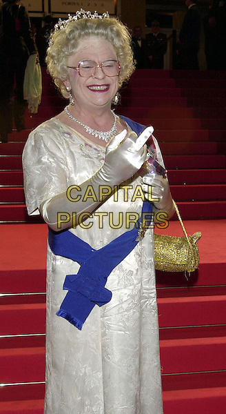 "NOT THE QUEEN..Cannes Film Festival, France..NOT the Queen arriving at screening of ""24 Hour  Party People""..half length, half-length, rude gesture, finger..www.capitalpictures.com..sales@capitalpictures.com..©Capital Pictures"