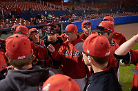 Ball State Cardinals head coach Rich Maloney (2) holds a team meeting before a game against the Wisconsin-Milwaukee Panthers on February 26, 2016 at Chain of Lakes Stadium in Winter Haven, Florida.  Ball State defeated Wisconsin-Milwaukee 11-5.  (Mike Janes/Four Seam Images)