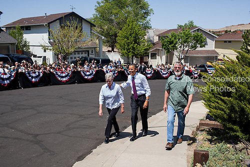 United States President Barack Obama walks with Valerie and Paul Keller to their home to discuss the economy and mortgage refinancing, in Reno, Nevada, May 11, 2012. .Mandatory Credit: Pete Souza - White House via CNP