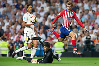Antoine Griezmann of Atletico Madrid and Thibaut Courtois of Real Madrid during the match between Real Madrid v Atletico Madrid of LaLiga, date 7, 2018-2019 season. Santiago Bernabéu Stadium. Madrid, Spain - 29 SEP 2018.