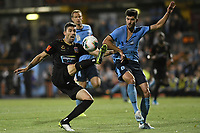 1st November 2019; Leichhardt Oval, Sydney, New South Wales, Australia; A League Football, Sydney Football Club versus Newcastle Jets; Jason Hoffman of Newcastle Jets kicks the ball whilst holding the jersey of Paulo Retre of Sydney   - Editorial Use