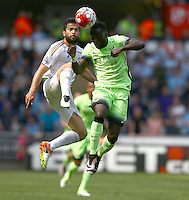 Jordi Amat of Swansea City and Bacary Sagna of Manchester City in action during the Barclays Premier League match between Swansea City and Manchester City played at The Liberty Stadium, Swansea on 15th May 2016