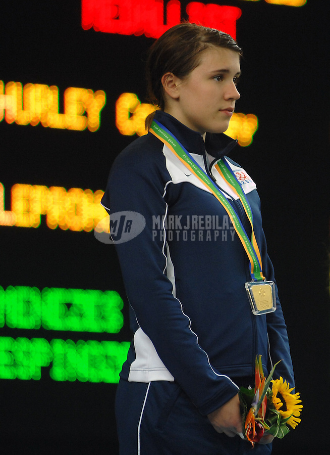 Jul 17, 2007; Rio de Janeiro, Brazil; Courtney Hurley (USA) on the podium after winning the gold medal in the womens individual epee final in the Pan American Games at the Rio Centro Pavilion in Rio de Janeiro. Mandatory Credit: Mark J. Rebilas-US PRESSWIRE Copyright © 2007 Mark J. Rebilas
