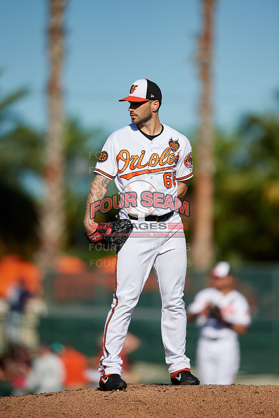 Baltimore Orioles relief pitcher Tanner Scott (66) looks in for the sign during a Grapefruit League Spring Training game against the Detroit Tigers on March 3, 2019 at Ed Smith Stadium in Sarasota, Florida.  Baltimore defeated Detroit 7-5.  (Mike Janes/Four Seam Images)