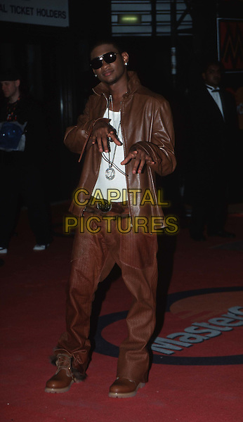 USHER ..MOBO Awards..brown leather jacket and trousers, sunglasses, shades, pointing, full length, full-length..www.capitalpictures.com..sales@capitalpictures.com..©Capital Pictures