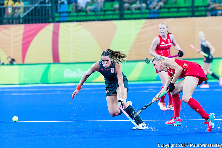 Alex Danson #15 of Great Britain passes before Lidewij Welten #12 of Netherlands can intercept during Netherlands vs Great Britain in the gold medal final at the Rio 2016 Olympics at the Olympic Hockey Centre in Rio de Janeiro, Brazil.