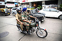Mumbai, India<br /> Two men in military uniform and one in a turban ride motorcycle through Colaba area past famous Leopolds restaurant.<br /> <br /> <br /> <br /> <br /> Picture by Gavin Rodgers/ Pixel8000<br />  07917221968