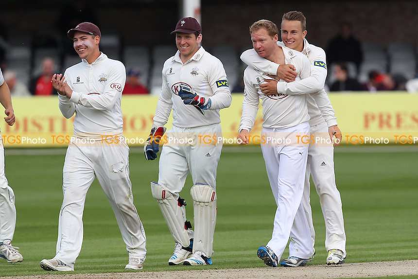 Gareth Batty (2nd R) of Surrey is congratulated on the wicket of Jaik Mickleburgh - Essex CCC vs Surrey CCC - LV County Championship Division Two Cricket at the Essex County Ground, Chelmsford, Essex - 25/05/14 - MANDATORY CREDIT: Gavin Ellis/TGSPHOTO - Self billing applies where appropriate - 0845 094 6026 - contact@tgsphoto.co.uk - NO UNPAID USE