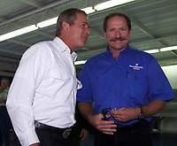 Texas Governor and US Presidential candidate George W. Nush (left) shares a laugh with NASCAR driver Dale Earnhardt in the garage area at Daytona International Speedway on Saturday, 7/1/00.  Bush was at the track as the Grand Marshall for the Pepsi 400 NASCAR race. (Photo by Brian Cleary)