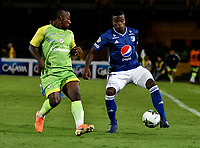 BOGOTÁ-COLOMBIA, 03–08-2019: Andrés Román de Millonarios y Pablo Rojas de Jaguares de Córdoba F.C. disputan el balón, durante partido entre Millonarios y Jaguares de Córdoba F.C. de la fecha 4 por la Liga Águila II 2019  jugado en el estadio Nemesio Camacho El Campín de la ciudad de Bogotá. / Andres Roman of Millonarios and Pablo Rojas of Jaguares de Cordoba F. C. figth for the ball, during a match between Millonarios and Jaguares de Cordoba F. C. of the 4th date for the Aguila Leguaje II 2019 played at the Nemesio Camacho El Campin Stadium in Bogota city, Photo: VizzorImage / Luis Ramírez / Staff.