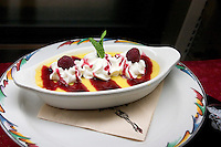 Enjoy fine dining with a Raspberry dessert at the Salt Rock Grill located on The Narrows of the Gulf Intercoastal Waterway.  Indian Shores Tampa Bay Area Florida USA