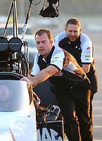 Feb 13, 2016; Pomona, CA, USA; Crew members for NHRA top fuel driver Steve Torrence during qualifying for the Winternationals at Auto Club Raceway at Pomona. Mandatory Credit: Mark J. Rebilas-USA TODAY Sports