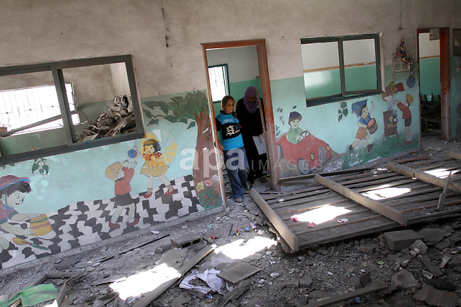 Palestinians inspect  the damage in the kindergarten that was destroyed by an overnight Israeli air raid in Beit Lahia, on August 25, 2011. A series of Israeli air strikes on Gaza over the past 24 hours have killed five Palestinians and injured 30, a spokesman for the emergency services told. Photo by Mohammed Asad