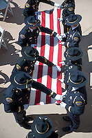 An honor guard comprised of Huntington Beach police and firefighters unfurls the special World Trace Center flag to be flown during the 9/11 ceremony.<br /> <br /> ///ADDITIONAL INFORMATION: hb.0915.memorial &ndash; 9/11/16 &ndash; MICHAEL KITADA, ORANGE COUNTY REGISTER - _DSC8579.jpg - <br /> Summary: The Huntington Beach Police Officers' Foundation's 9-11 Memorial Committee unveils a $200,000 monument including steel from the toppled World Trade Center, at City Hall. The event will include music, a flyover, New York police and others with connections to the 9-11 rescue and victims of the tragedy.