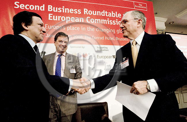 BRUSSELS - BELGIUM - 29 JANUARY 2008 --  Economist Conferences, Second Business Roundtable with the European Commission - Securing Europe's place in the changing global economy. -- Jose Manuel BARROSO (Le) the President of the EU-Commission shaking hands with Craig MUNDIE (Ri), Chief Research and Strategy Officer, Microsoft and John PEET, Europe Editor, The Economist. -- PHOTO: Juha ROININEN / EUP-IMAGES