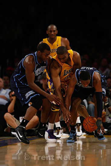 Los Angeles - Utah Jazz vs. Los Angeles Lakers basketball, game two NBA playoffs, Tuesday April 21, 2009 at the Staples Center..Utah Jazz forward Paul Millsap (24) Los Angeles Lakers center Andrew Bynum (17) Los Angeles Lakers guard Kobe Bryant (24) Utah Jazz forward C.J. Miles (34)