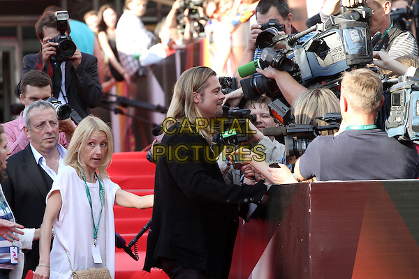 Brad Pitt <br /> The opening of the Moscow International Film Festival, Moscow, Russia.<br /> June 20th, 2013<br /> half length black top suit jacket side profile photographers press cameras <br /> CAP/PER/LS<br /> &copy;LS/PersonaStars/CapitalPictures