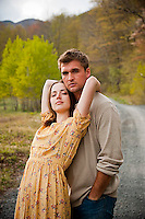 Young couple embracing on country road
