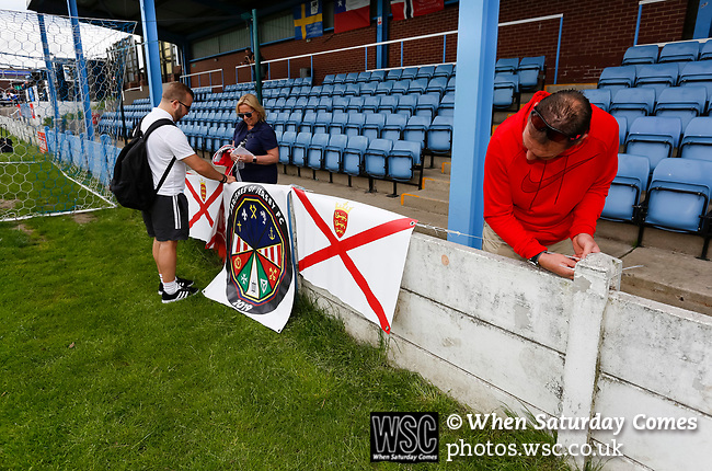 Jersey fans securing their banners. Yorkshire v Parishes of Jersey, CONIFA Heritage Cup, Ingfield Stadium, Ossett. Yorkshire's first competitive game. The Yorkshire International Football Association was formed in 2017 and accepted by CONIFA in 2018. Their first competative fixture saw them host Parishes of Jersey in the Heritage Cup at Ingfield stadium in Ossett. Yorkshire won 1-0 with a 93 minute goal in front of 521 people. Photo by Paul Thompson