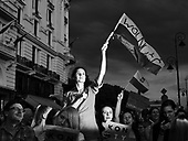 Warsaw / Poland, July 24, 2017<br /> People attend a protest against judicial reforms in Warsaw. A woman holding a Polish flag with inscription &quot;Freedom&quot;<br /> Photo: Adam Lach / Napo Images<br /> <br /> <br /> Ludzie uczestniczą w proteście przeciwko reformom sądownictwa w Warszawie. <br /> Photo: Adam Lach / Napo Images