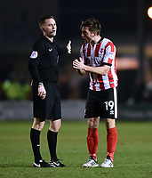 Lincoln City's Lee Frecklington speaks to Referee Ross Joyce<br /> <br /> Photographer Chris Vaughan/CameraSport<br /> <br /> The EFL Sky Bet League Two - Lincoln City v Notts County - Saturday 13th January 2018 - Sincil Bank - Lincoln<br /> <br /> World Copyright &copy; 2018 CameraSport. All rights reserved. 43 Linden Ave. Countesthorpe. Leicester. England. LE8 5PG - Tel: +44 (0) 116 277 4147 - admin@camerasport.com - www.camerasport.com