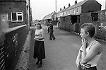 South Kirkby Colliery Yorkshire England. 1979. Kids playing, typical miners terraced housing in Duke Street.